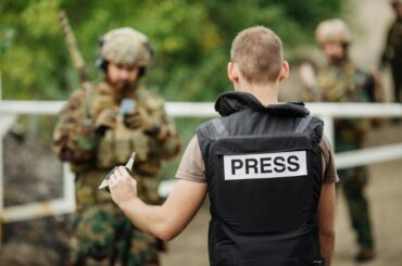 Press journalist reporting in military situation
